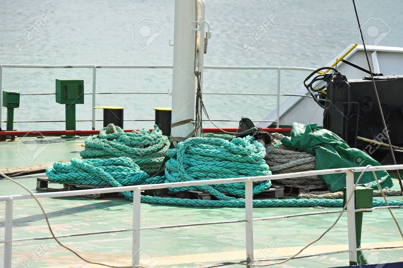 Old blue mooring rope on ship deck