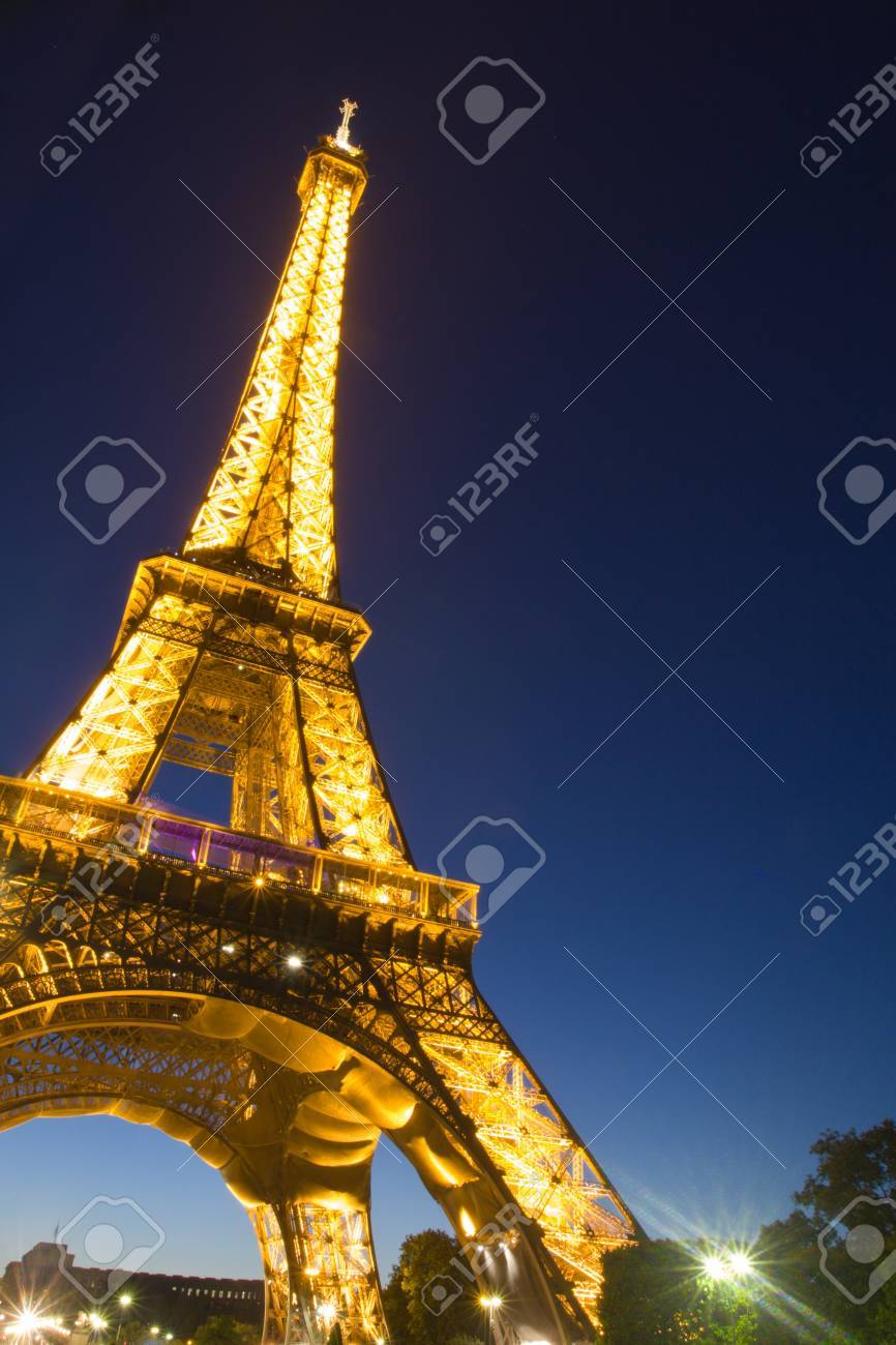 PARIS - July 20 : Eiffel tower and Invalides at night on July 20, 2010 in Paris. The Eiffel tower is the most visited monument of France.  Stock Photo - 8608187