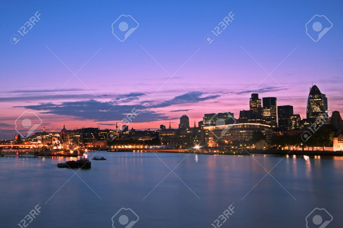 Skyline of the City of London at dusk. Thames River on foreground, copy space in the sky Stock Photo - 10544675