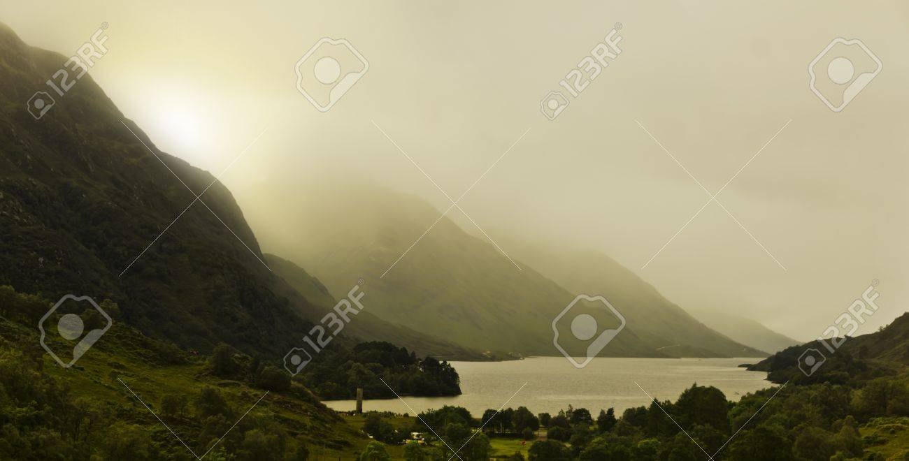 sunrise in the scottish highlands, mountains are covered in fog and clouds Stock Photo - 15466141