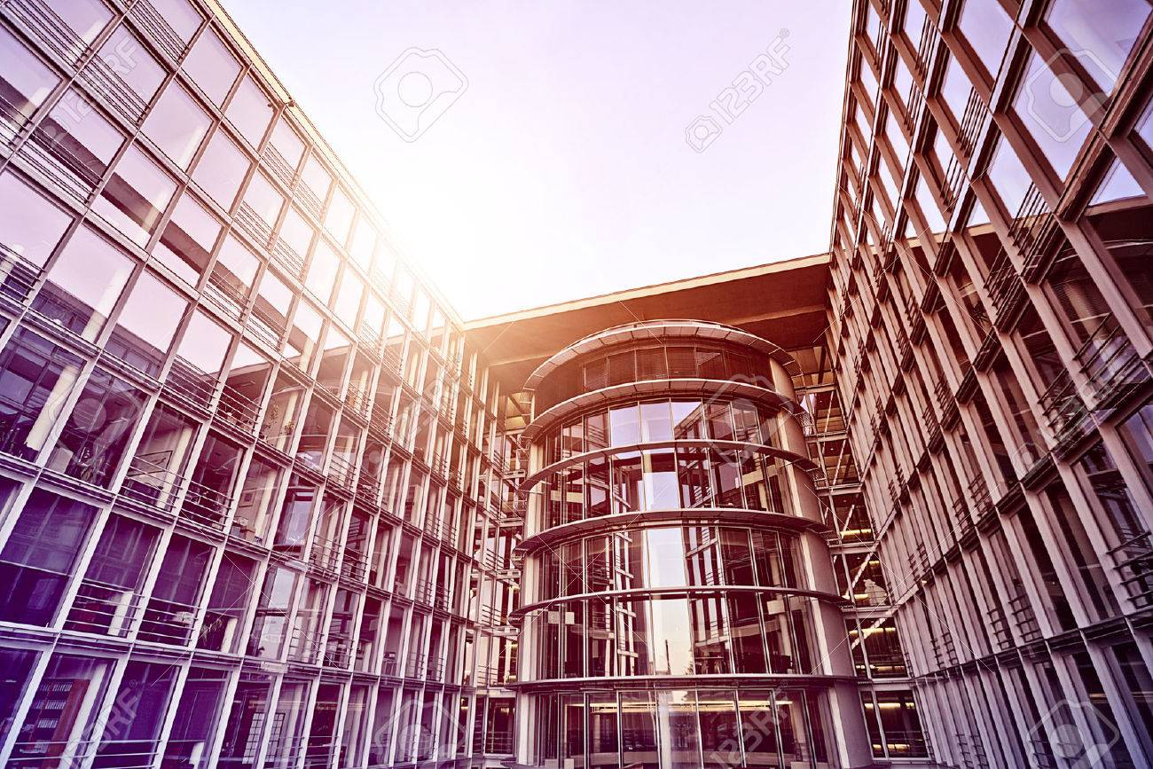 modern glass and steel office building in the sun, Berlin, Germany - 36438956