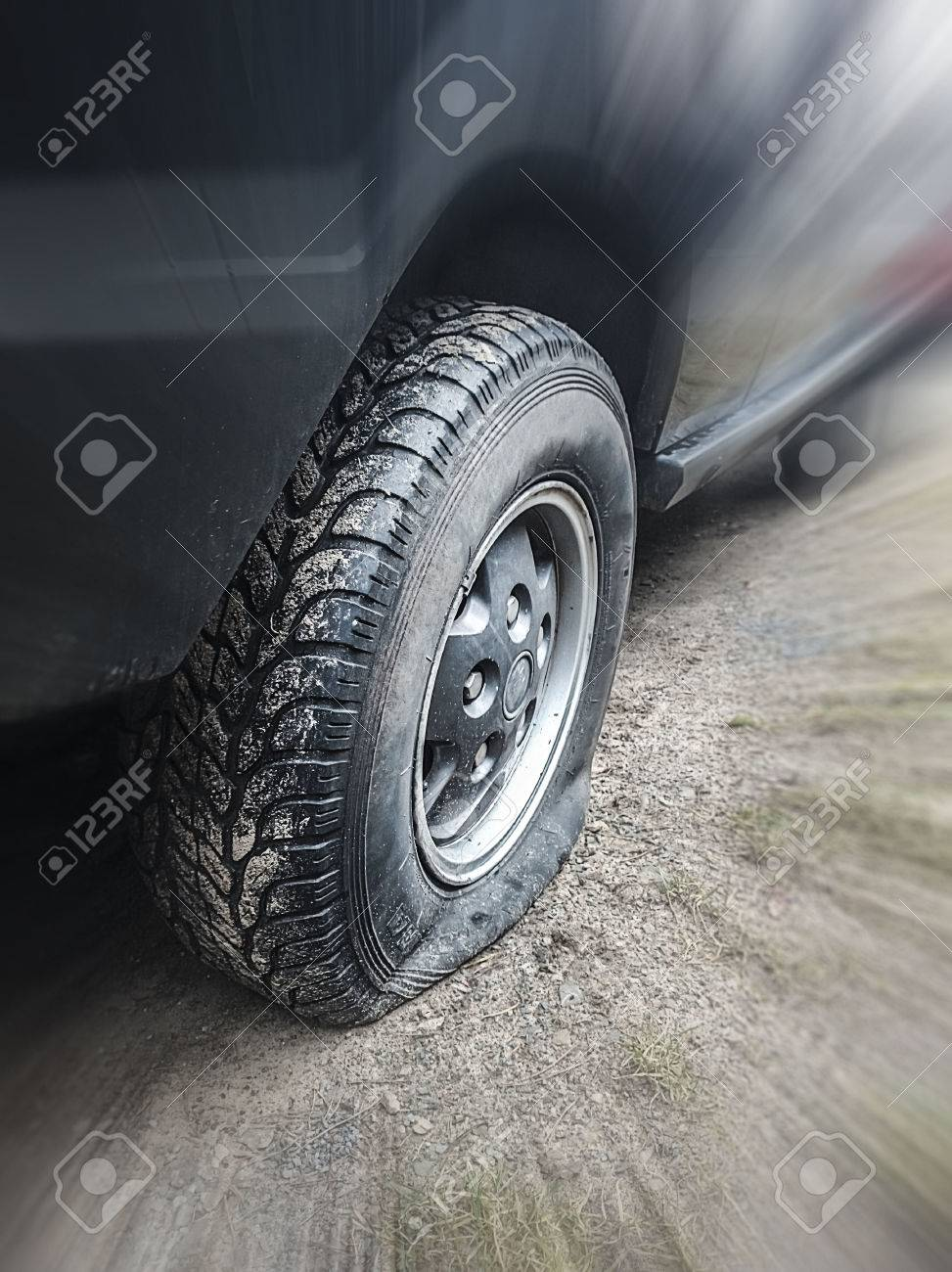 flat tire of a vehicle, intentional blur - 40241667