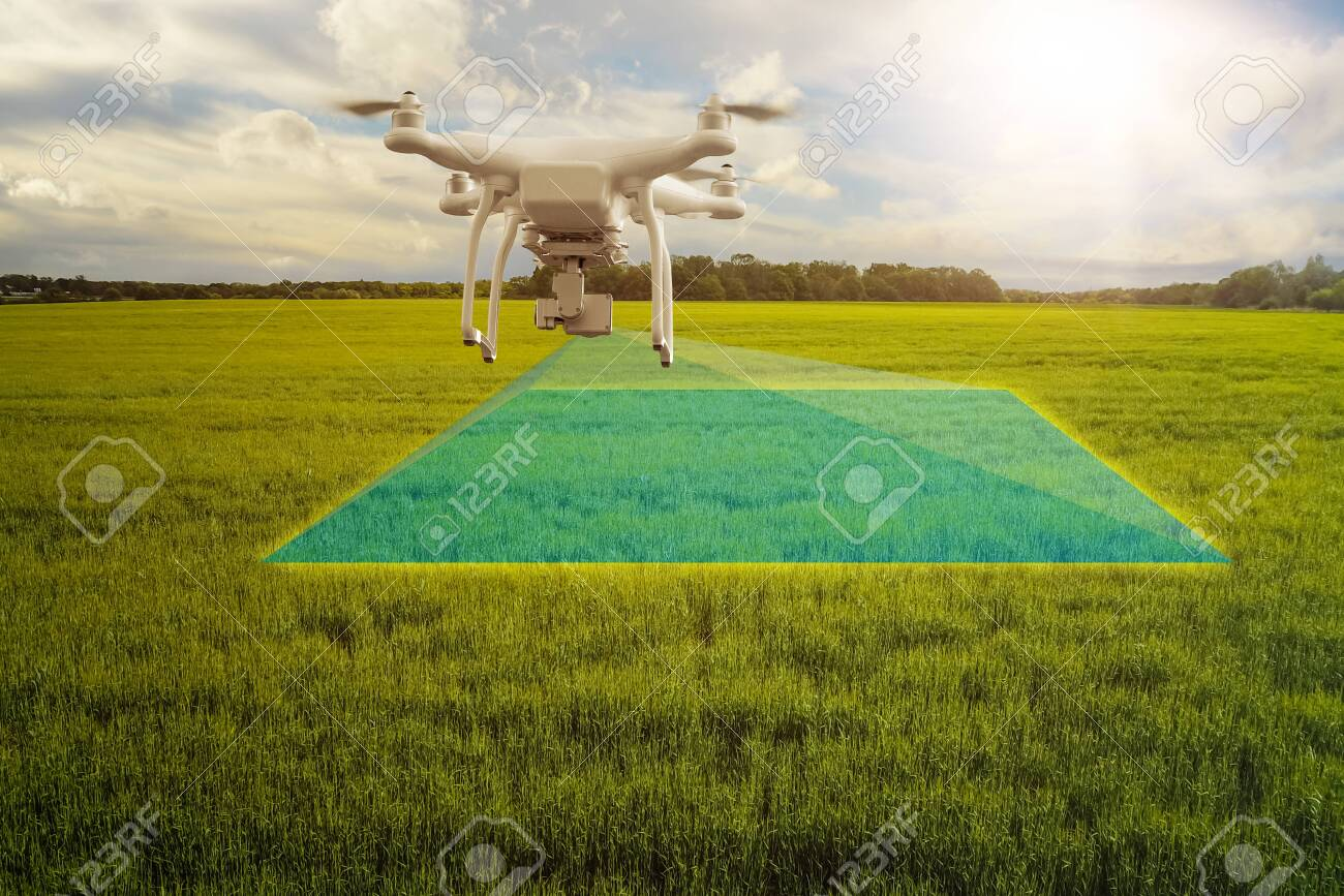 UAV drone multicopter flying with high resolution digital camera over a crops field, agriculture concept - 132166146
