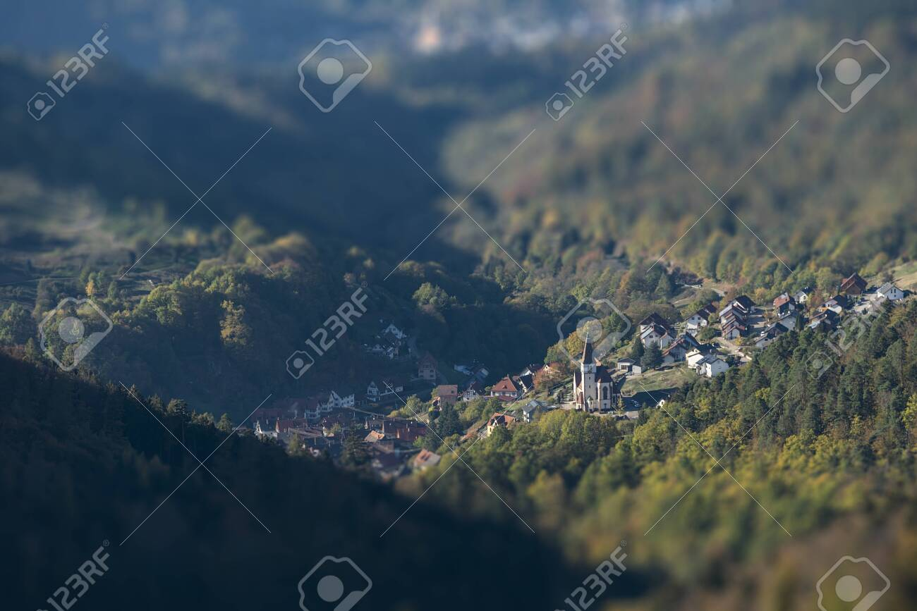 aerial view over a small village in the black forest with intentional tilt-shift blur - 132456309