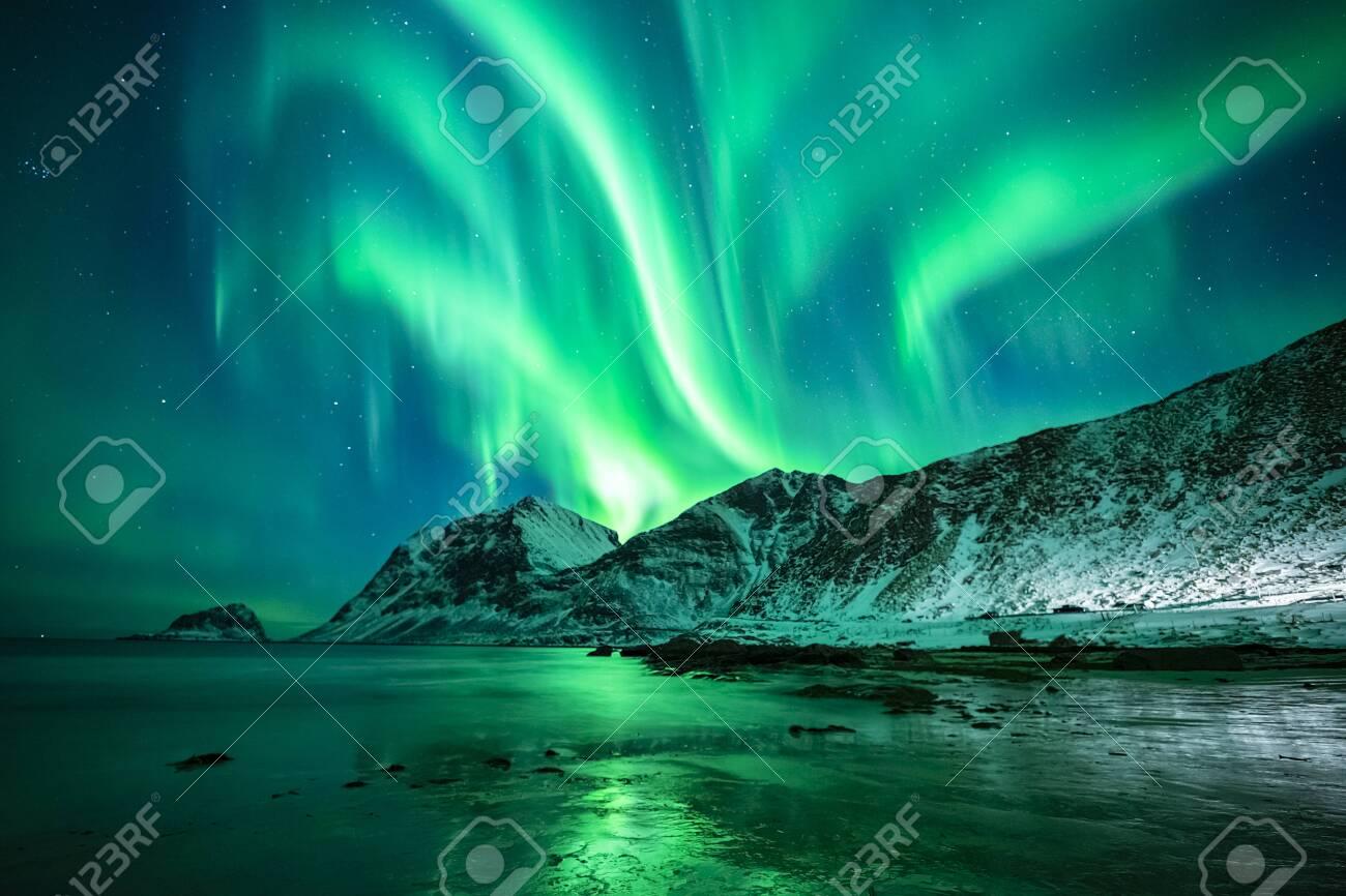 beautiful northern lights over winter sea and mountain scene, lofoten, norway - 132456043