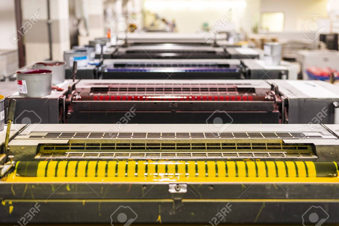 top view of an offset sheetfed printing maschine in a printing facility - 132166306