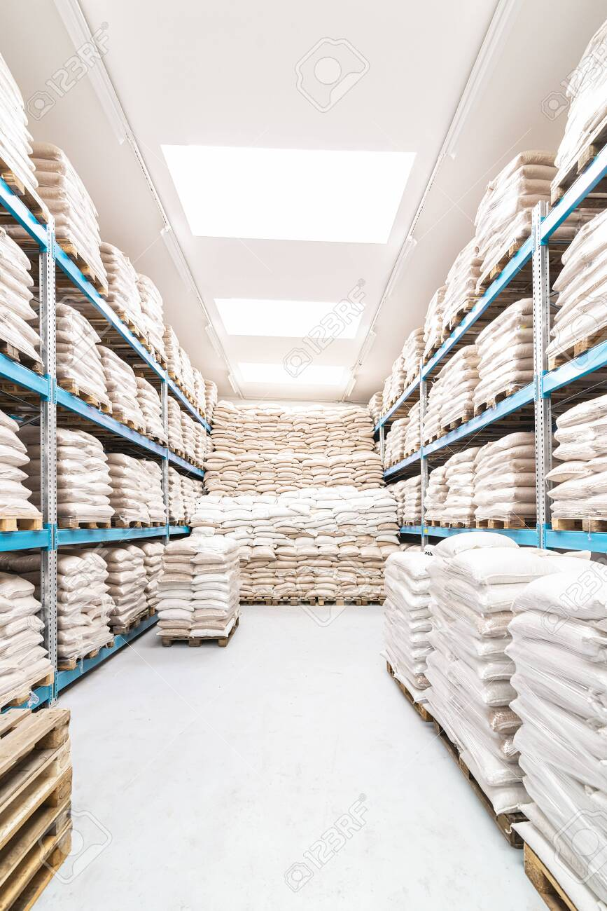 clean and open warehouse stacked with white sacks - 132456077