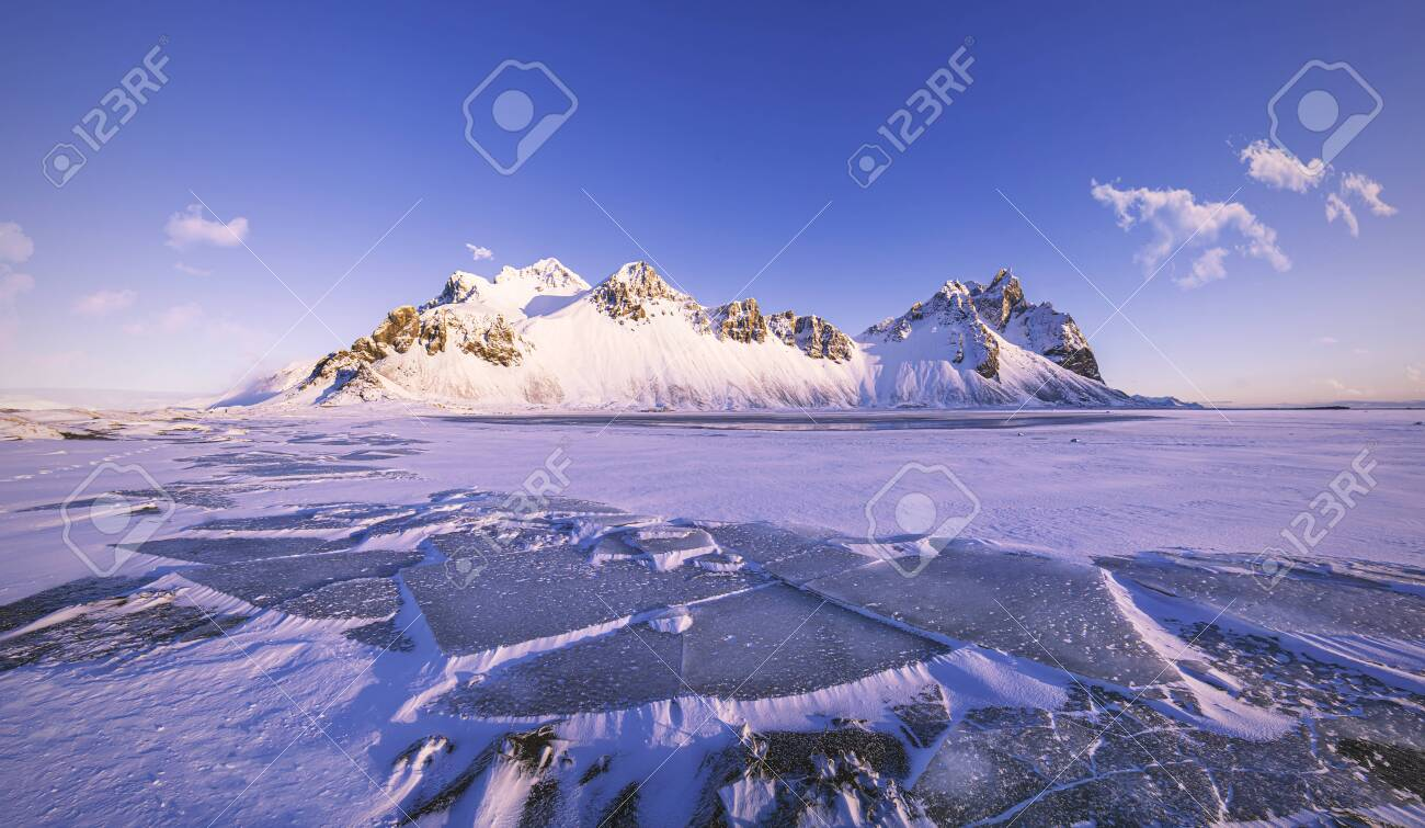 Vestrahorn Mountains on Stokksnes cape with ice floes in front, beautiful winter morning scenery, Iceland - 146361871