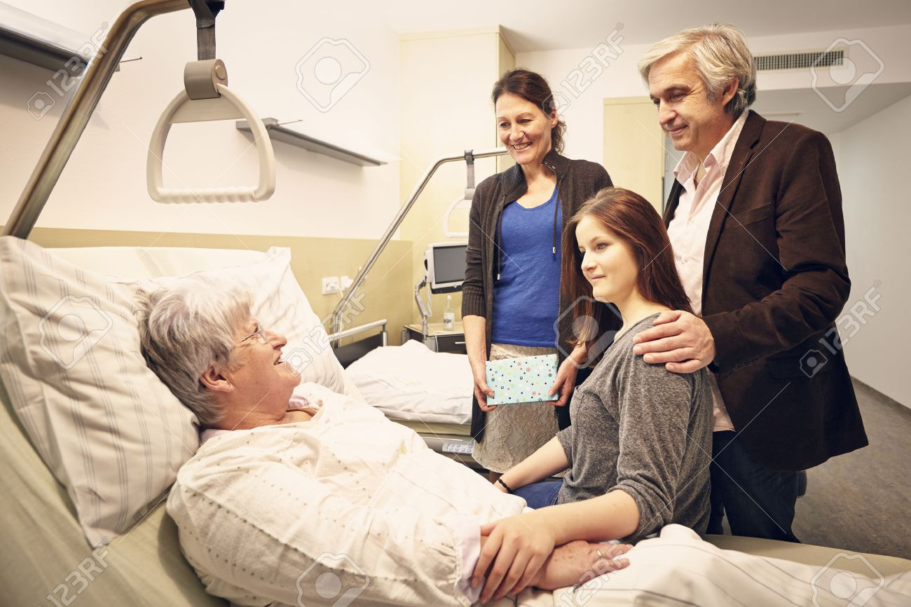 Hospital room with patient and family - Hospital Visit Family With Patient Stock Photo 28103984