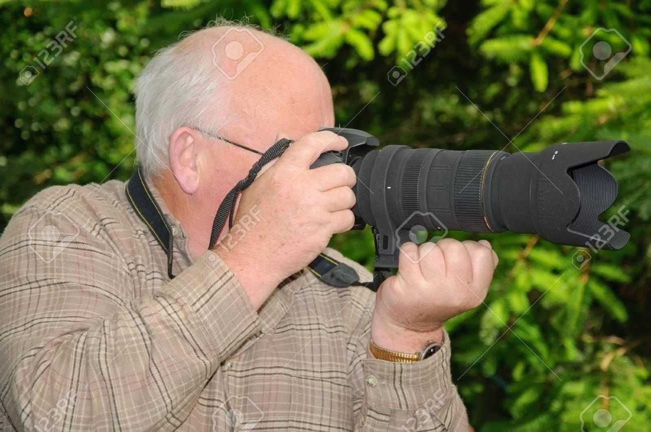 closeup image of senior using a long range zoom lens Stock Photo - 5240884