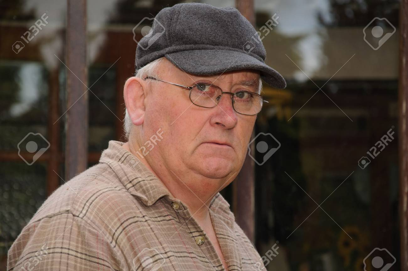 portrait of an older senior male glasses and cap Stock Photo - 5240876