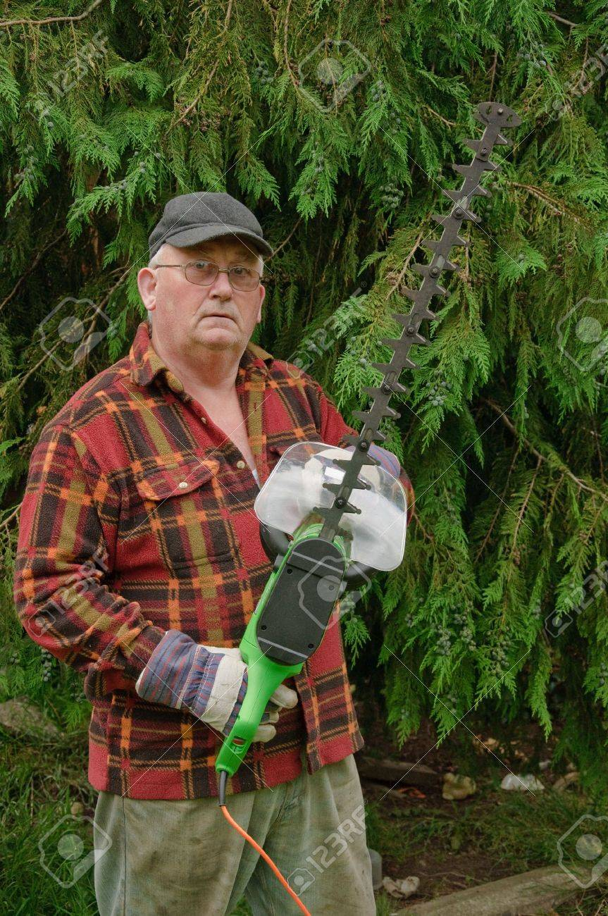 in Garden With Chainsaw