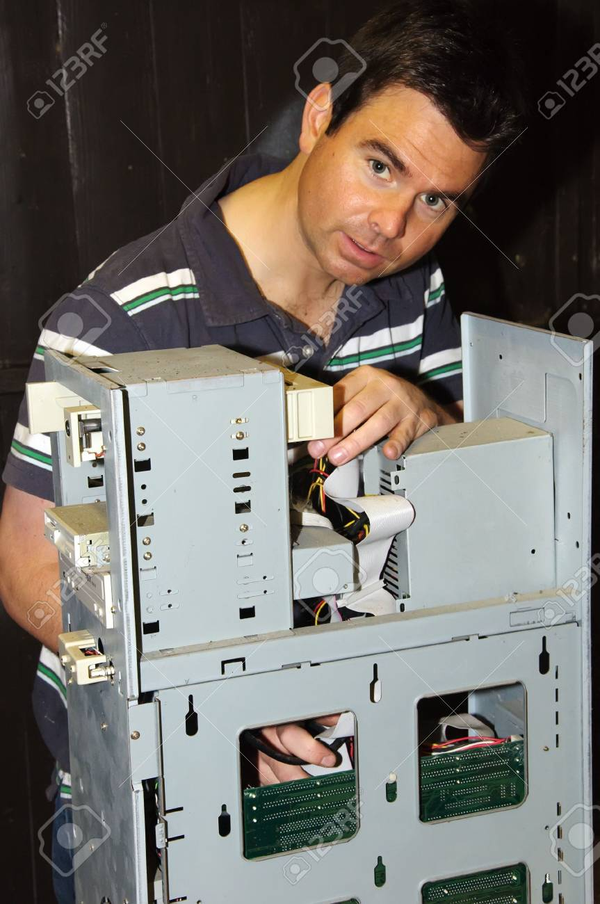 picture of male working on fixing a server computer Stock Photo - 5288110