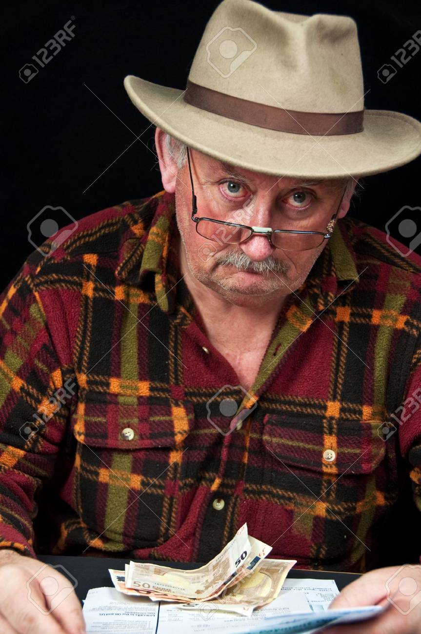 photo senior male with money issues on black background Stock Photo - 6222284