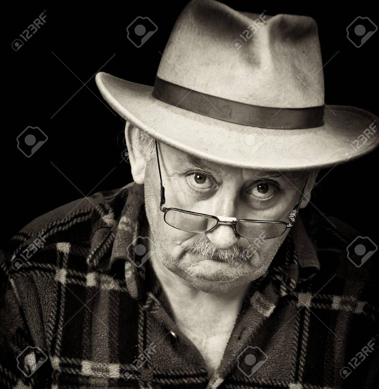 photo of senior male with sad or grumpy face portrait - 7610152