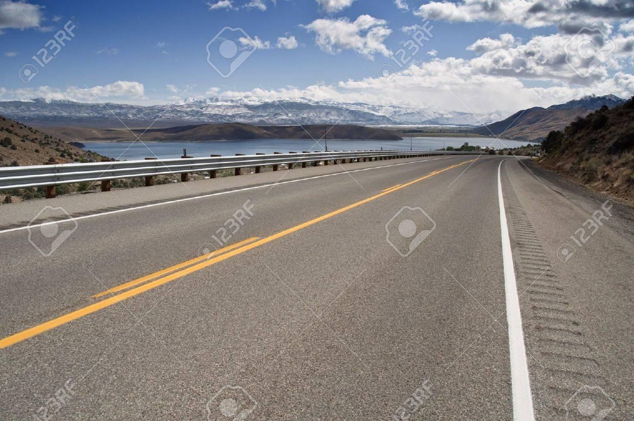 photo transport road through a countryside mountain range snow Stock Photo - 8042283