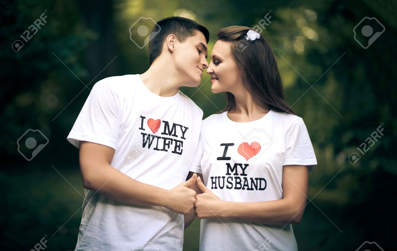 Stock Photo Young Husband And Wife With The Words On The T Shirt I Love My Wife I Love My Husband