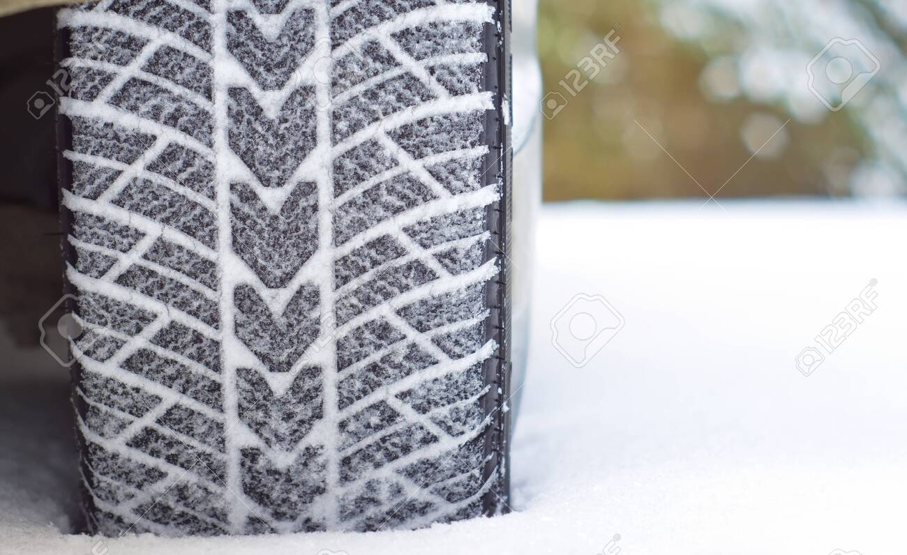 Winter tyres in snow Stock Photo - 26261623