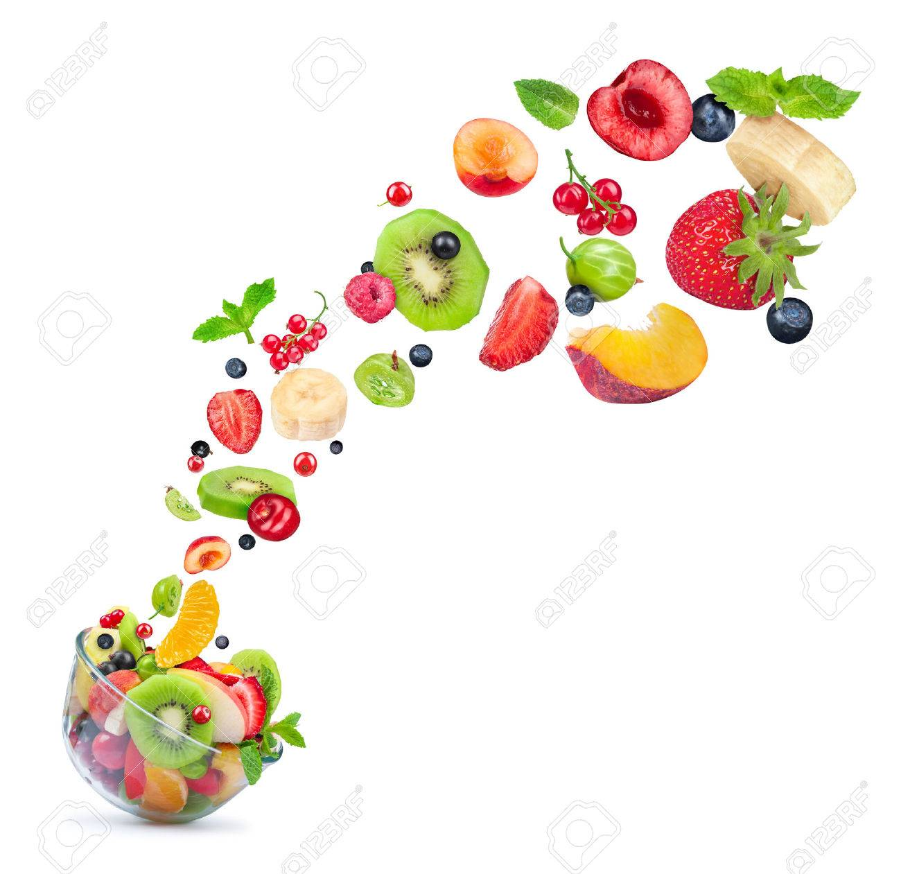fruit salad ingredients in the air in a glass bowl isolated on white background - 42739957
