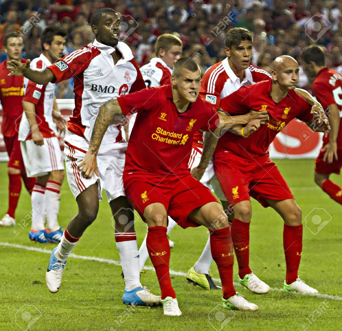 liverpool s martin skrtel front left and jonjo shelvey front stock photo picture and royalty free image image 14581605 liverpool s martin skrtel front left and jonjo shelvey front