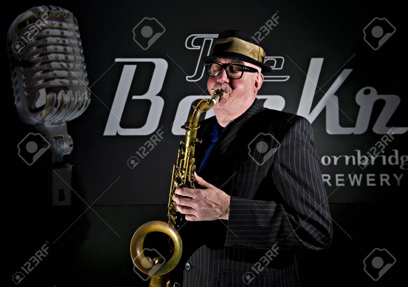 Musician Bob Swift playing the tenor saxophone during a gig at
