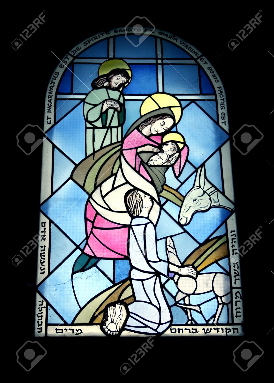 Stained glass window in the monastery of benedictines  19th century of baby Jesus, Mary, and Joseph in the manger with the animals. Stock Photo - 6179839