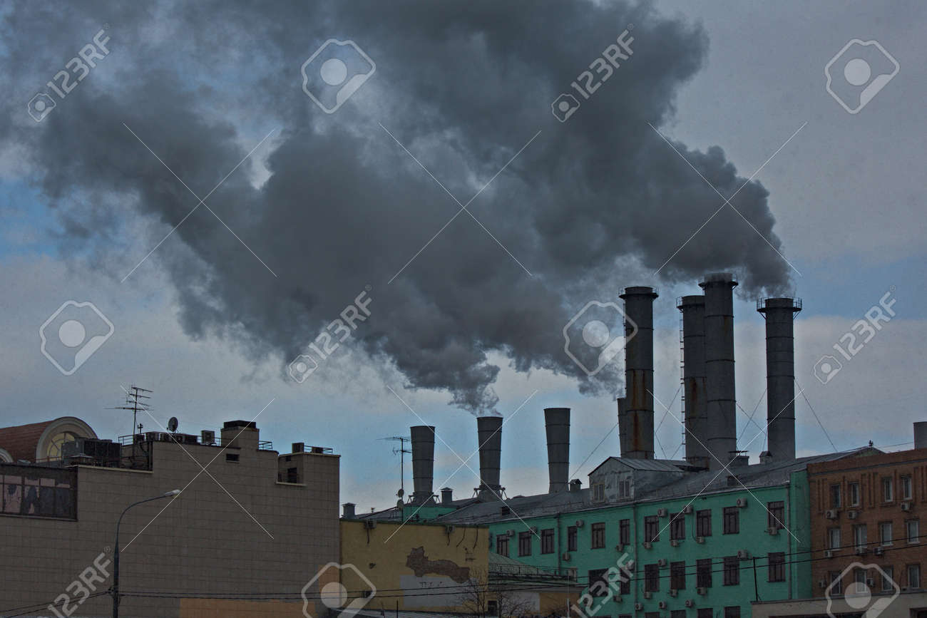 Smoking chimneys of a Moscow thermal power station in the city center. - 165284190