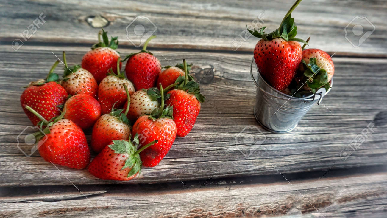 Fresh strawberries on wooden table. - 123655463