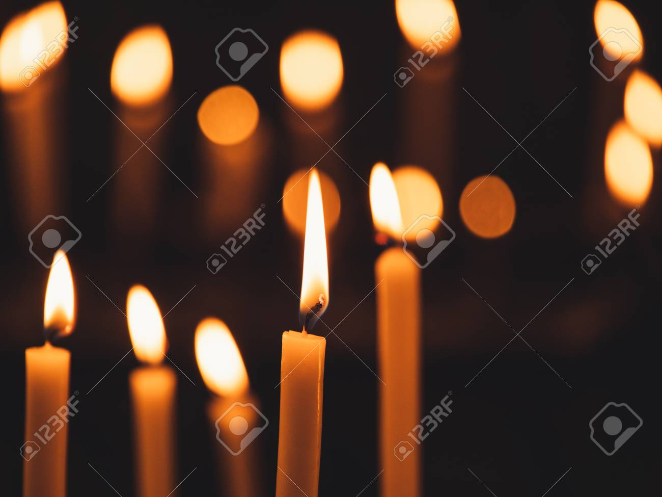 Image of many burning candles with shallow depth of field - 125707124