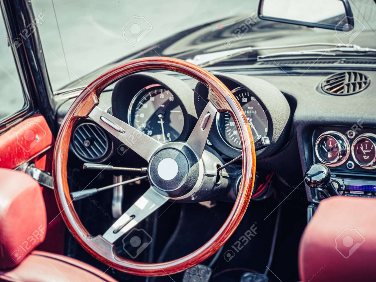 The steering wheel and dashboard of an antique classic car - 156989534