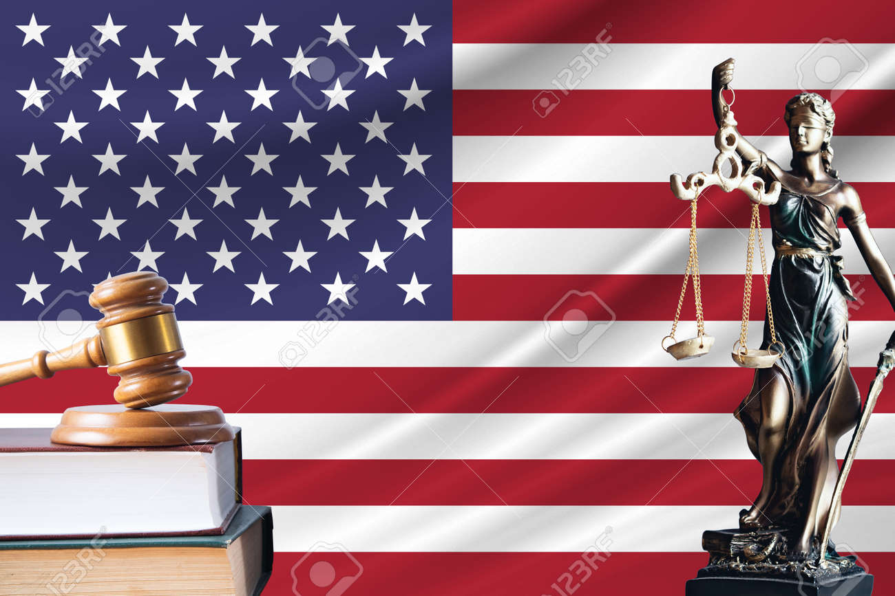 Law and justice in United States. Statue of themis and the gavel of the judge against the background of the flag of United States. Law and justice concept. - 171958758