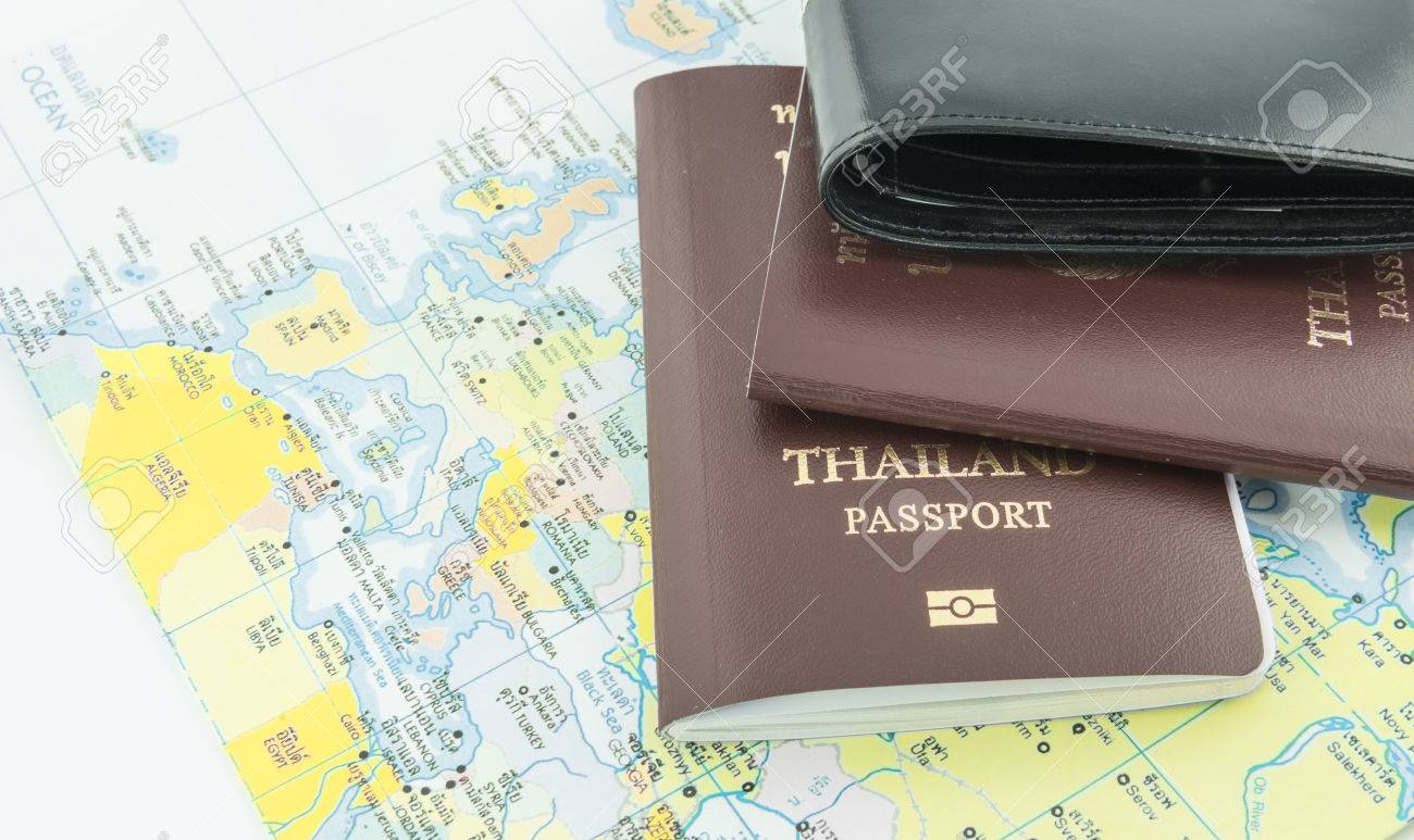 Purse And Passport To The World Map Stock Photo Picture And