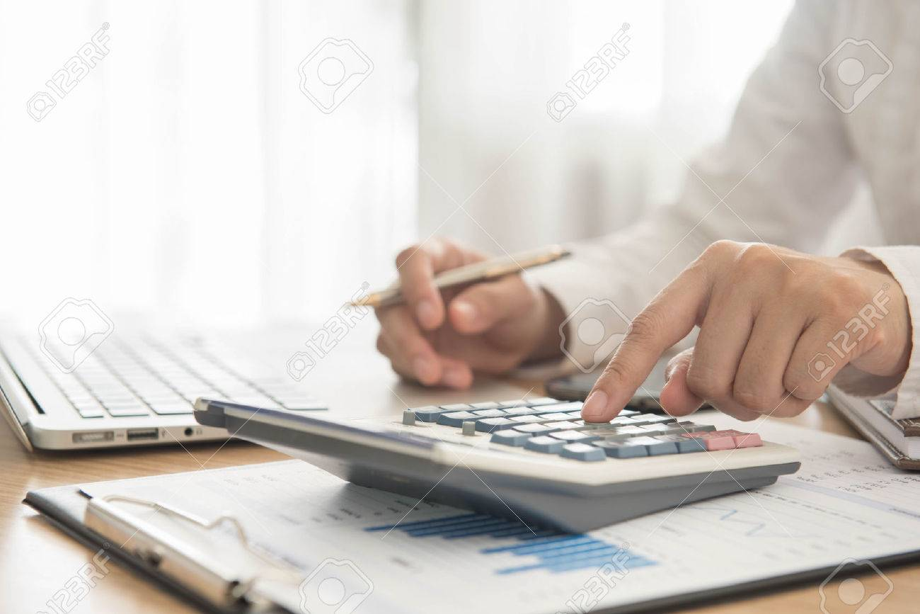 Accounting: Businessman Using A Calculator To Calculate The Numbers  Dogbreedswiththehighestperyearmedical