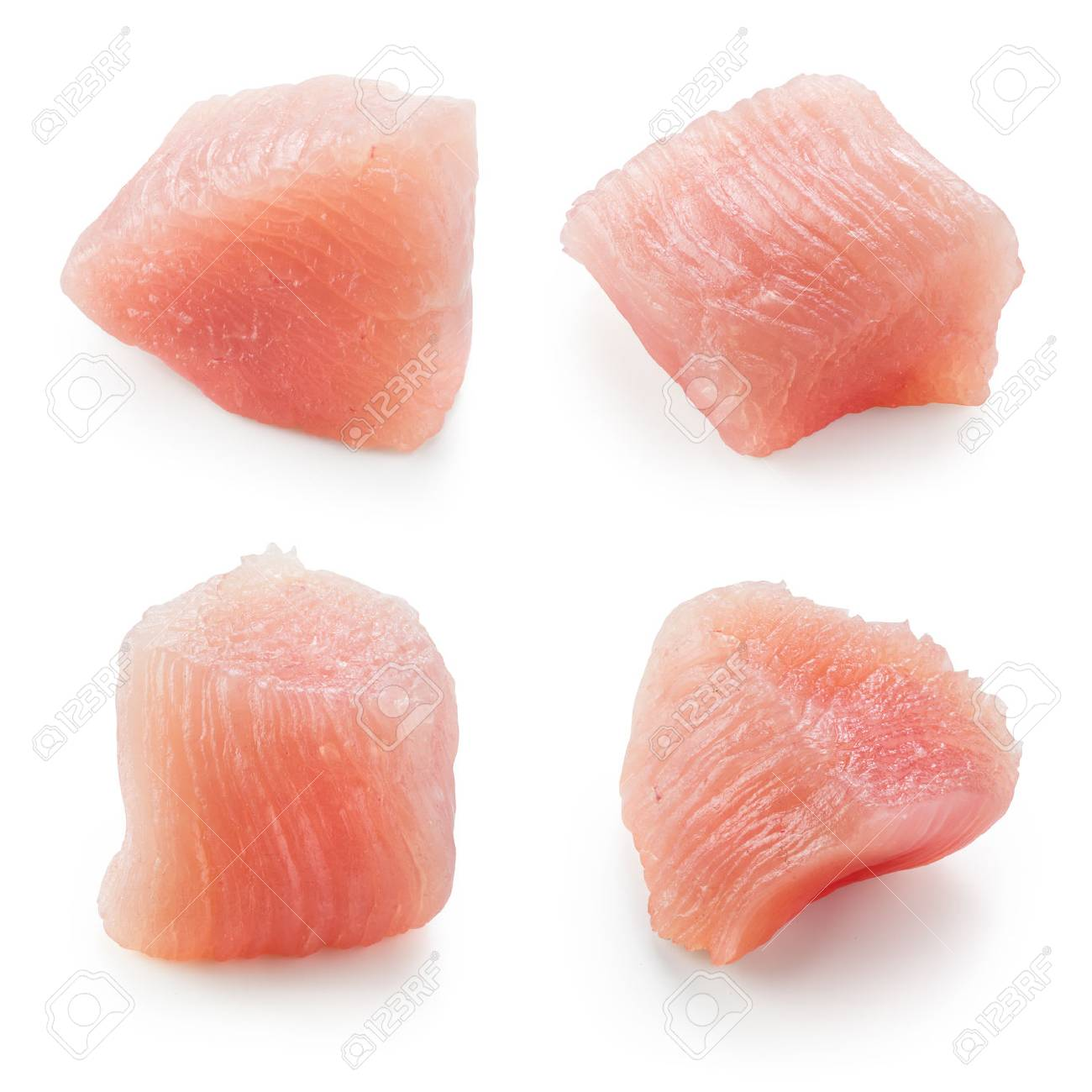 Raw chicken fillet. Small pieces of meat isolated on white. Collection. - 62034396
