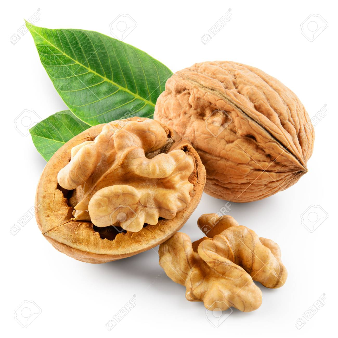 Walnuts with leaves in closeup. With clipping path. - 94503703