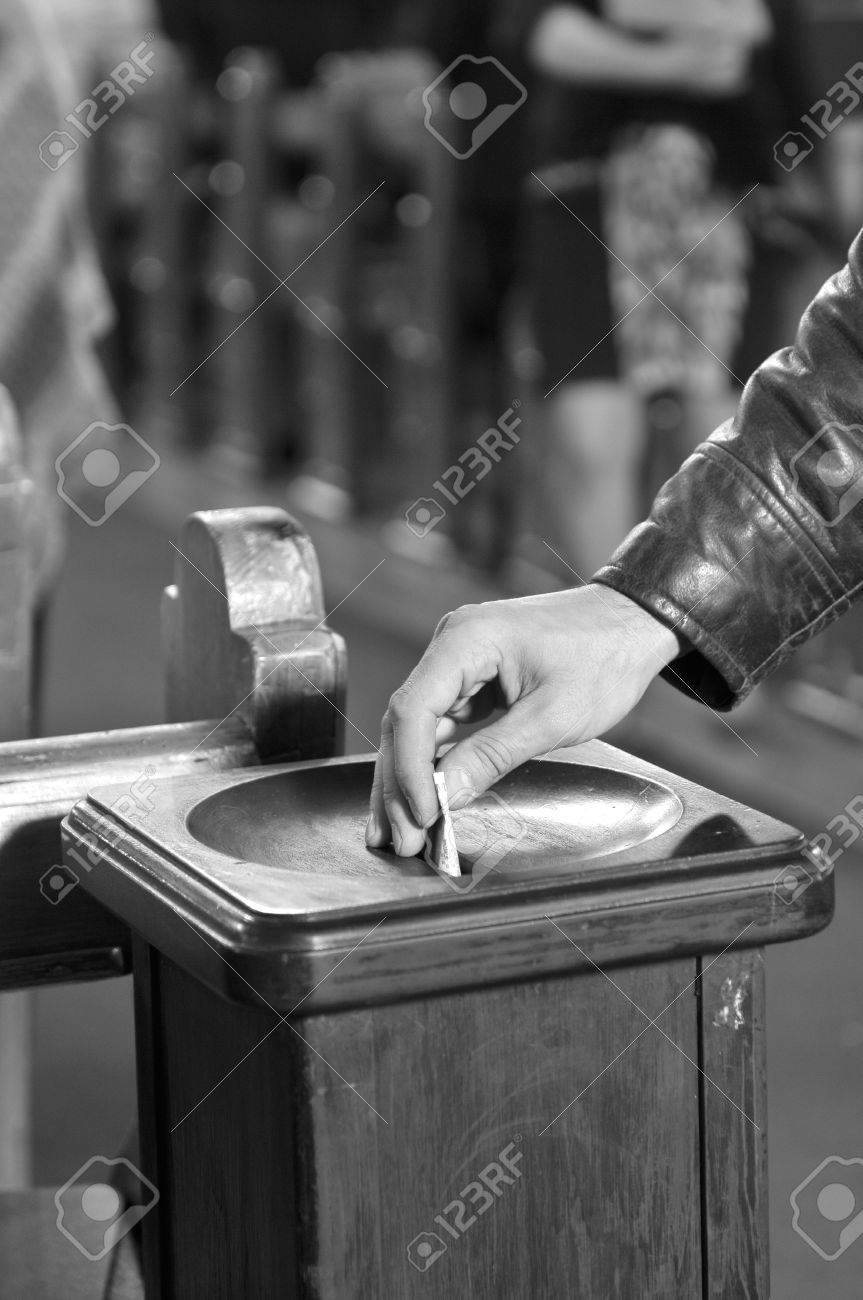 Inserting a banknote into donation box Stock Photo - 17360303