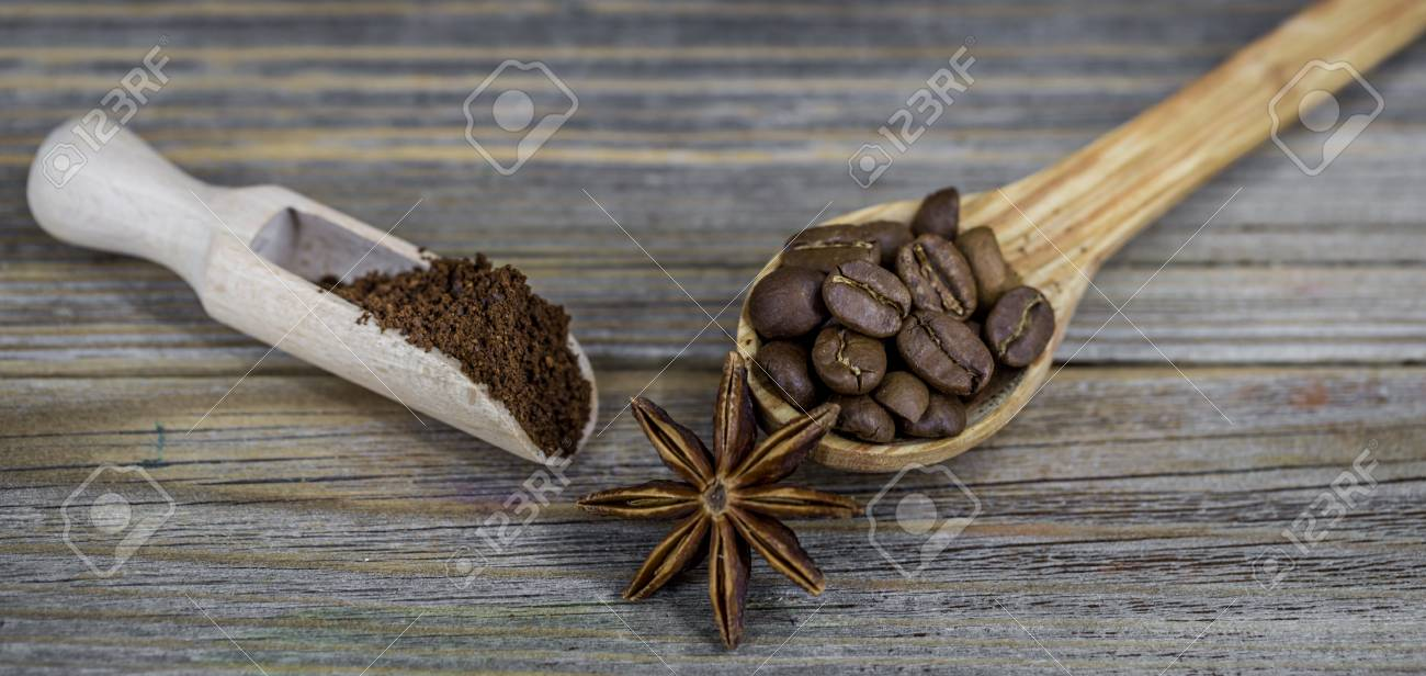 A Beautiful Little Wooden Spoon With Coffee On Wooden Background