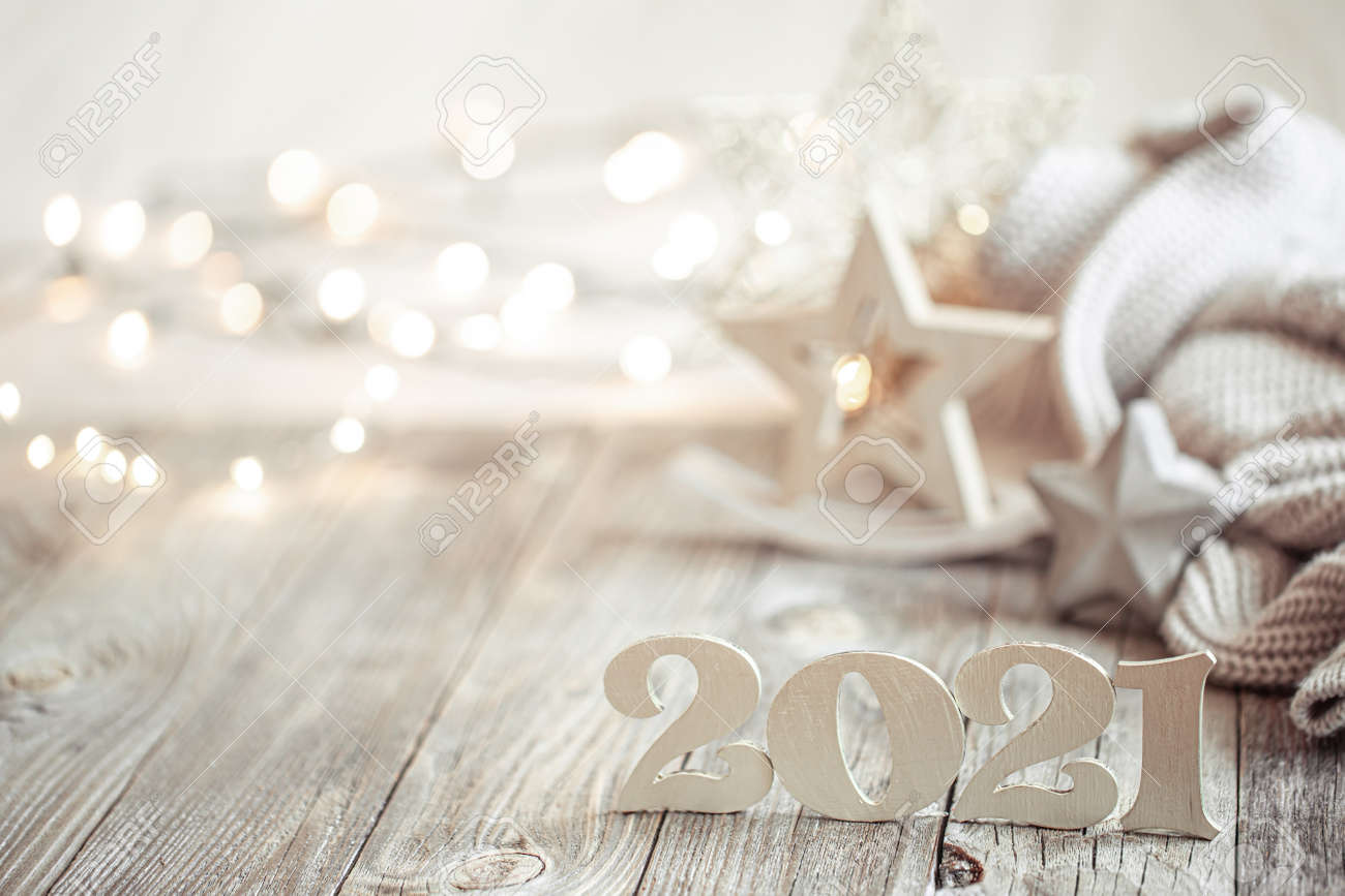 New year 2021 holiday background with decor. Blurry lights in the background. The concept of the celebration. - 155743889
