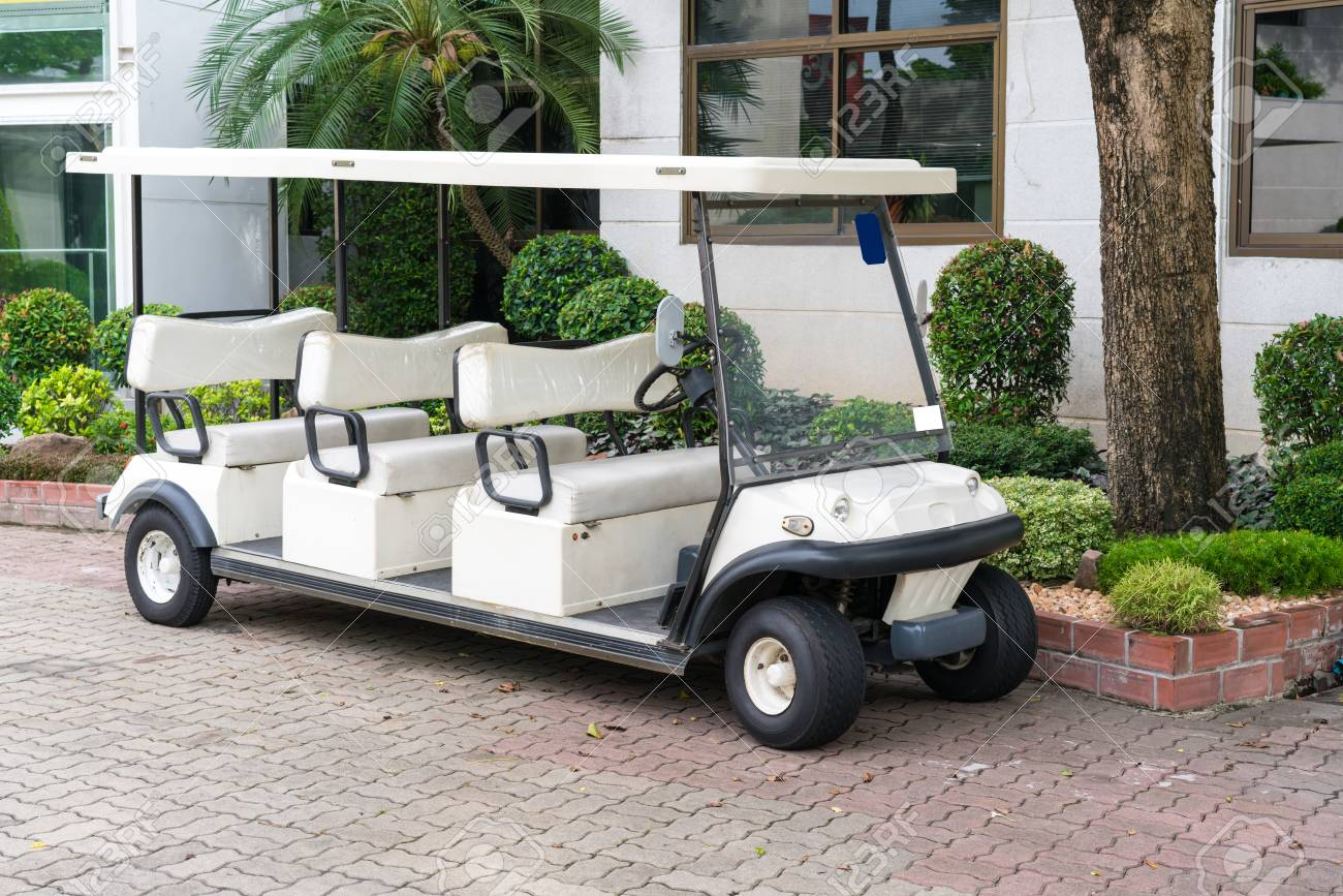 Picture of: White Golf Cart With Back Seats In The Public Park Waiting For Stock Photo Picture And Royalty Free Image Image 81384897