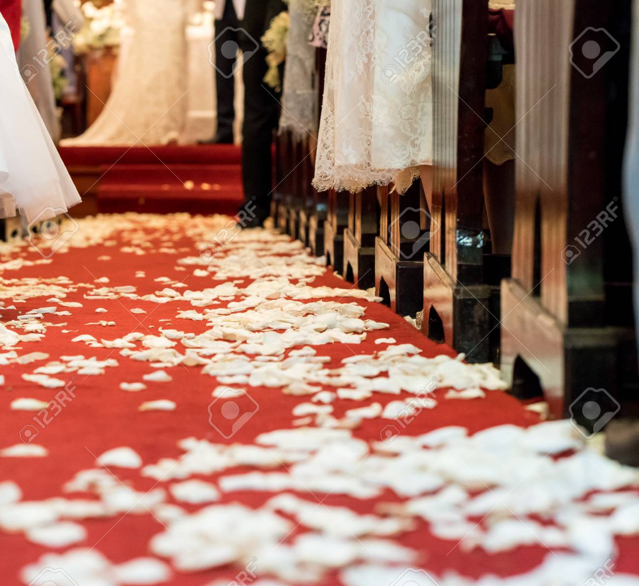 Closed Up White Flower Petals On Red Carpet Floor In Church At