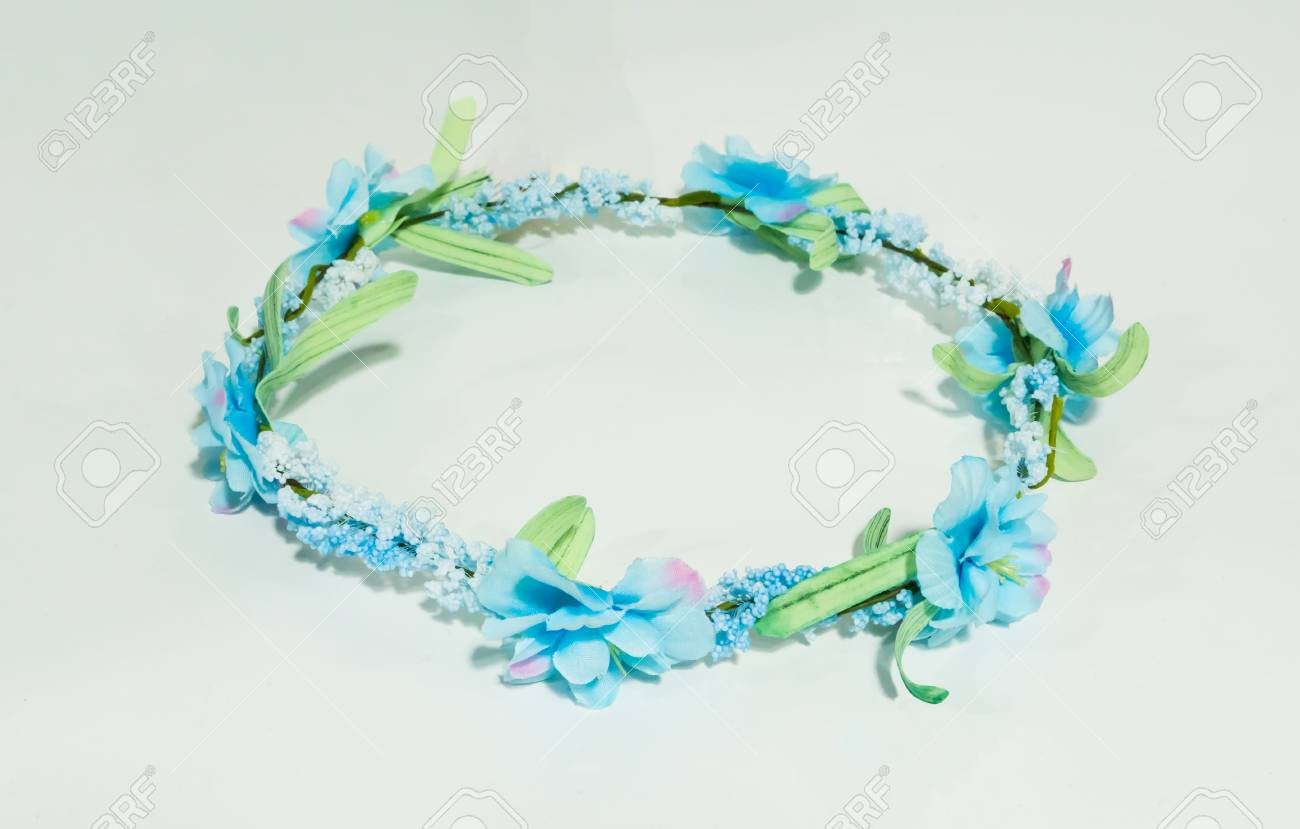 Artificial blue gypso green leaves and blue flower crown isolated artificial blue gypso green leaves and blue flower crown isolated on white background stock izmirmasajfo