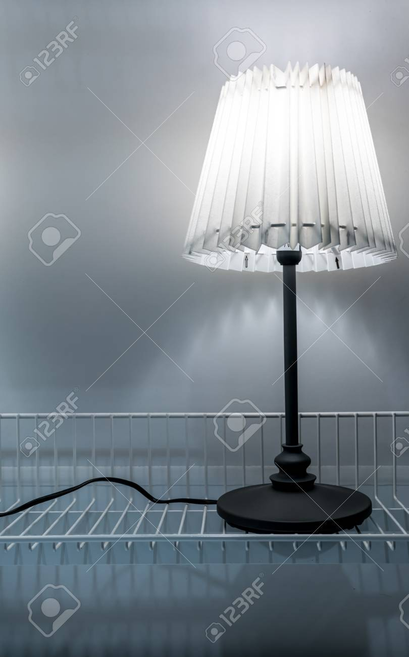 Antique Style Table Lamp Made From Paper Isolated On White Metal Rack  Against Its Shadow On