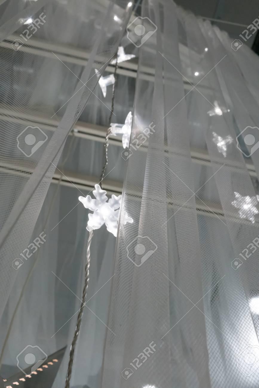 Illuminated Led Icicle Light Against Sheer Fabric Background Stock Photo Picture And Royalty Free Image Image 90705419