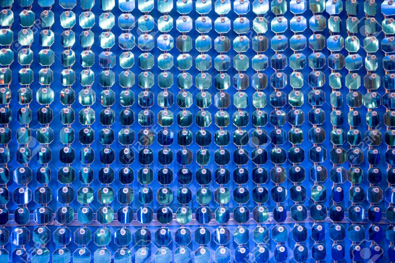 Glittering shiny blue sequin wall decoration for texture and background. Closed up view from lower angle. - 106791904