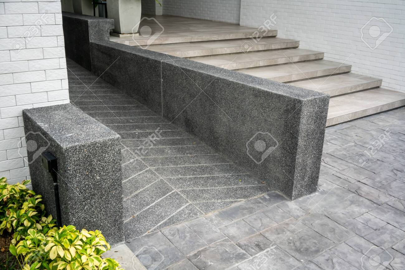 Ramped Access Using Wheelchair Ramp For Disabled People Concrete