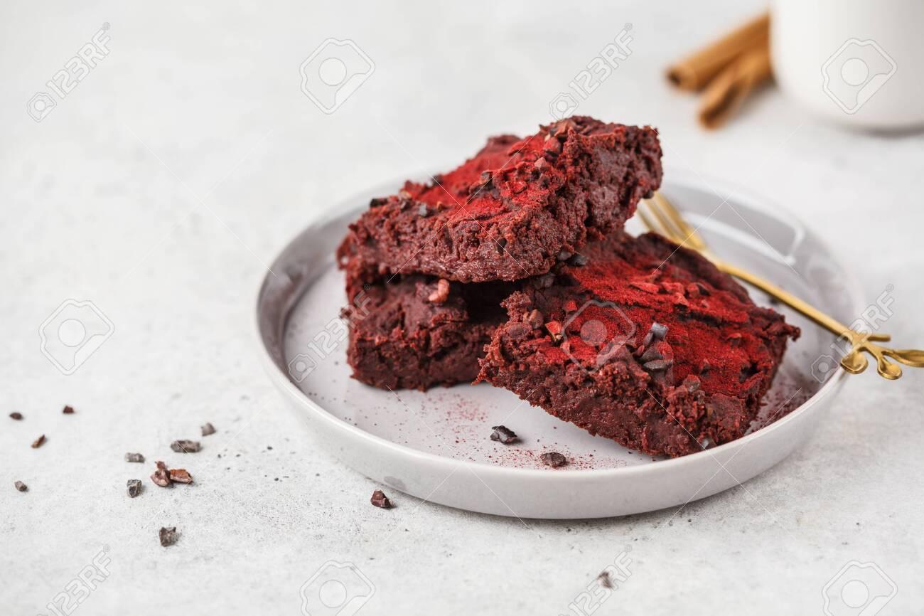 Beetroot vegan brownie on gray plate. Healthy vegan food concept. - 128400745