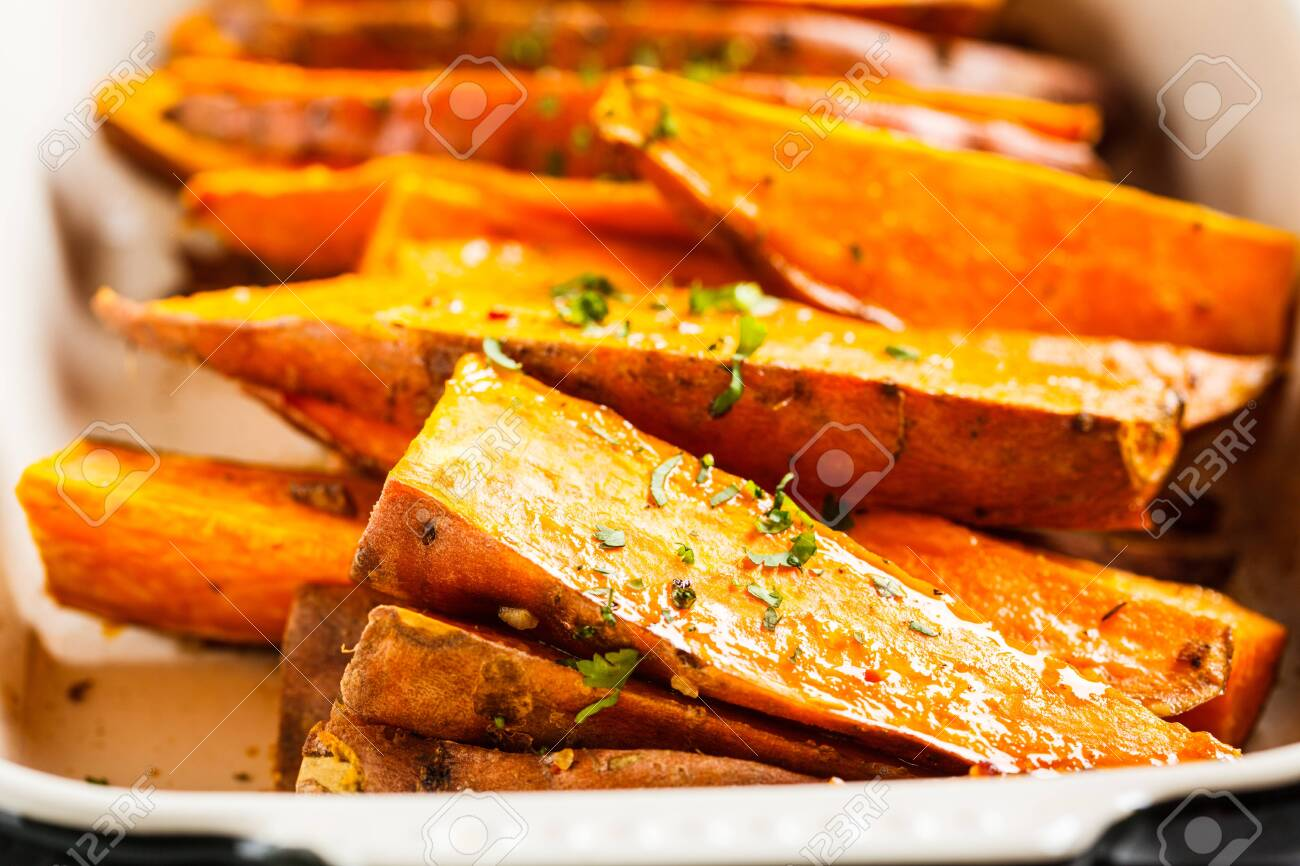 Baked Sweet Potato Slices With Spices In The Oven Dish Healthy Stock Photo Picture And Royalty Free Image Image 129419229