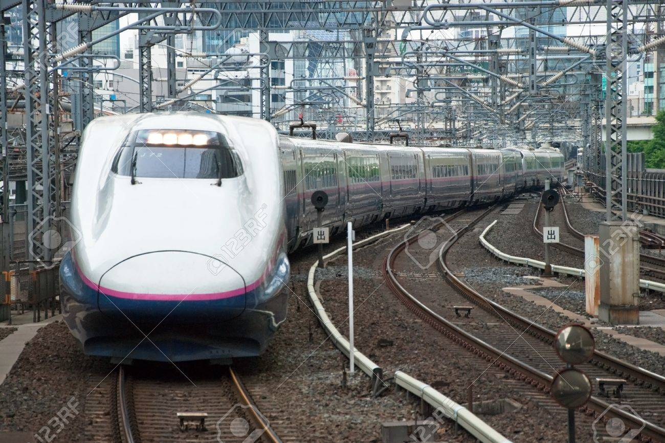 Tokyo, Japan � May 20, 2012: Shinkansen bullet train at Tokyo main railway station in May 2012 Tokyo, Japan.The Shinkansen is the world's busiest high-speed railway operated by four Japan Railways group companies. Stock Photo - 18431835