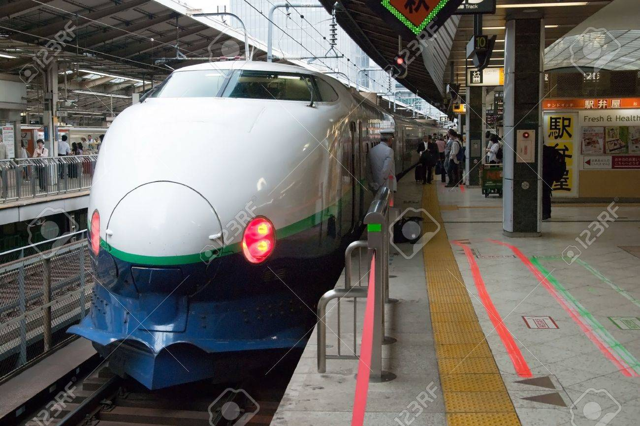 Tokyo, Japan - May 20, 2012: Shinkansen bullet train at Tokyo main railway station in May 20, 2012 Tokyo, Japan.Shinkansen is world's busiest high-speed railway operated by four Japan Railways group companies. Stock Photo - 18431825