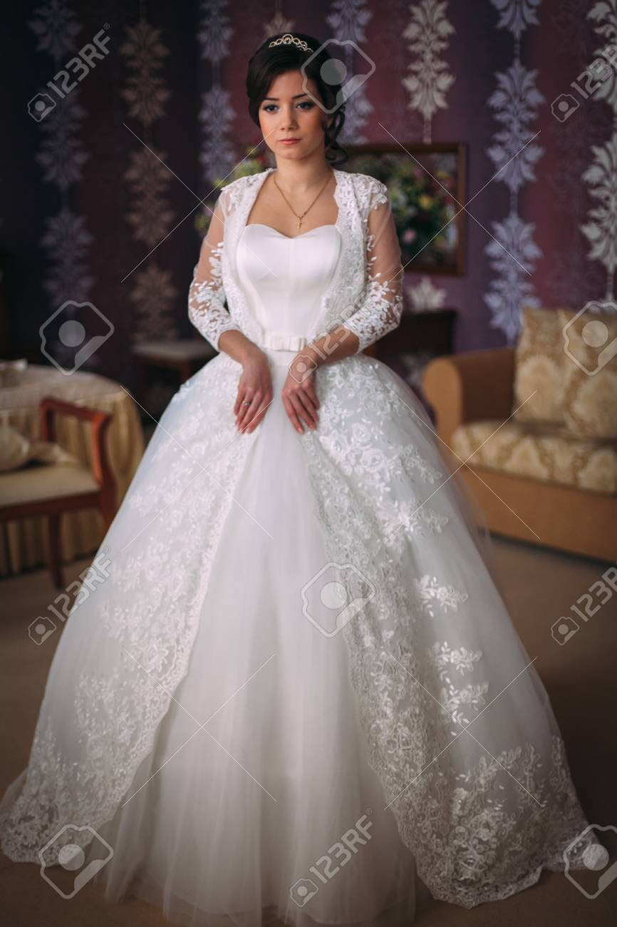 Beautiful Bride Brunette In A Long Wedding Dress In A Classic